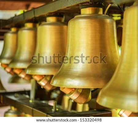 Bronze bells to call celebrations. - stock photo