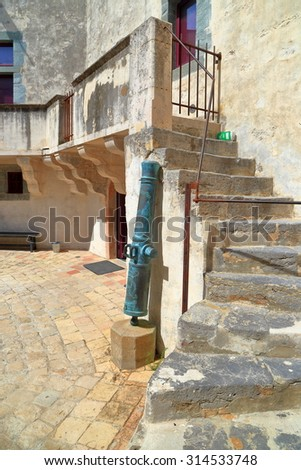 Bronze canons inside the medieval fortress of Saint Tropez, French Riviera, France - stock photo
