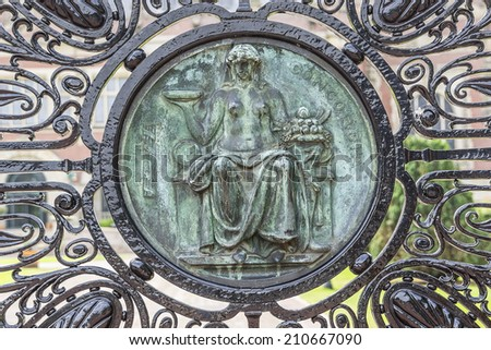 Bronze carving goddess on the entrance gate of the Peace Palace in The Hague, The Netherlands. - stock photo