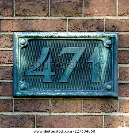 bronze cast house number four hundred and seventy-one - stock photo