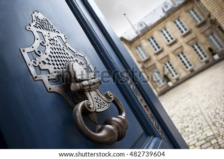 Bronze door knocker of a stylish French mansion in Bordeaux