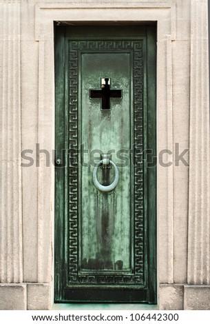 Bronze door of coffin chamber - stock photo