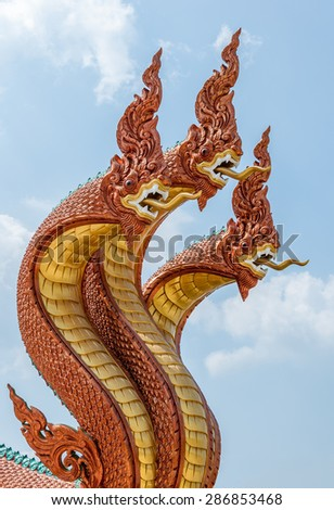 Bronze dragon sculpture in the traditional Thai style. - stock photo