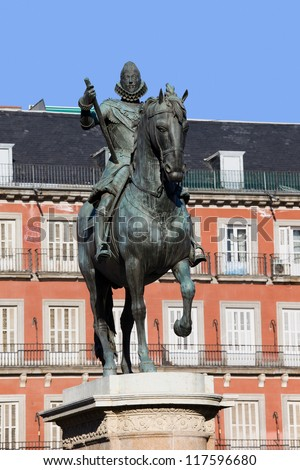 Bronze equestrian statue of King Philip III from 1616 at the Plaza Mayor in Madrid, Spain. - stock photo