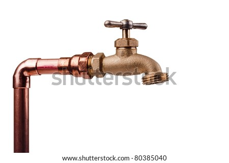 Bronze faucet attached to the water system of copper pipes. - stock photo