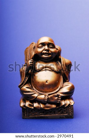 Bronze Figure of budha monk sitting in meditation - stock photo
