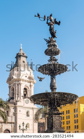 Bronze fountain and Cathedral, Plaza de Armas, Lima - stock photo
