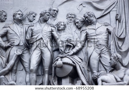 Bronze frieze at the base of Nelson's Column in Trafalgar Square showing a scene from the Battle of Copenhagen in 1801. - stock photo