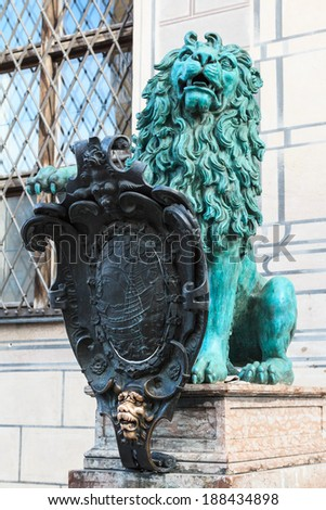 Bronze heraldic lion in front of a royal building named Alte Residenz in Munich, Germany - stock photo