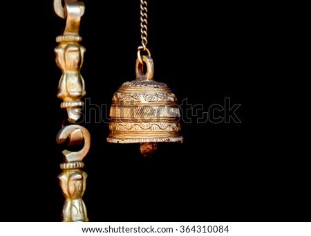 Bronze hindu holy bell against black background - stock photo