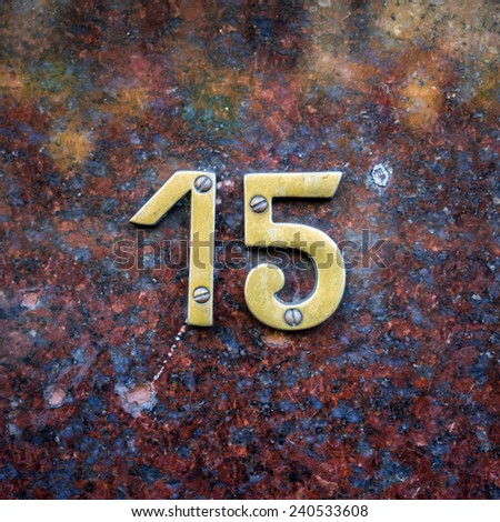 bronze house number fifteen - stock photo