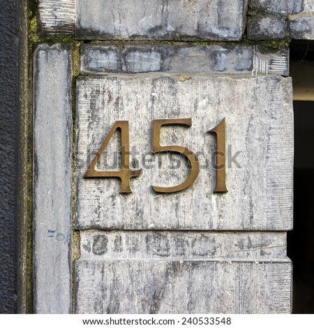 bronze house number four hundred and fifty one - stock photo