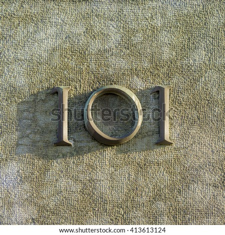 Bronze house number one hundred and one - stock photo