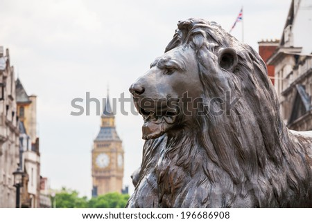 Bronze lion in Trafalgar Square with Big Ben in the background. London, England - stock photo
