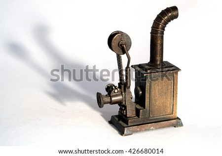 Bronze miniature of old movie projector with shadows                                - stock photo