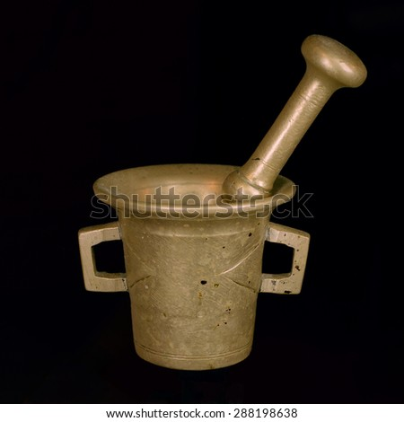 bronze mortar and pestle; isolated on black; high res film - stock photo