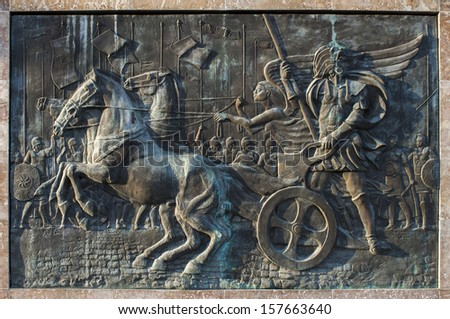 Bronze relief of Alexander the Great riding the chariot. Skopje, Macedonia - stock photo