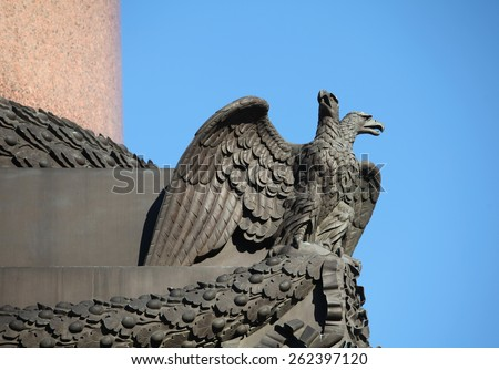 bronze sculpture double eagle Russian coat of arms against in blue sky