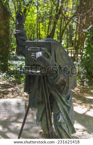 bronze sculpture of a photograph in a park - stock photo