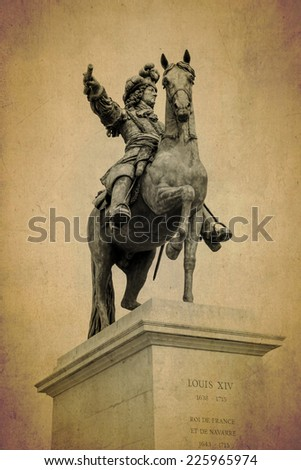 bronze sculpture of Louis XIV at Versailles palace on old background texture  - stock photo