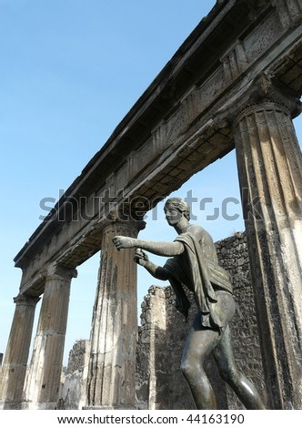 Bronze statue of Apollo in a ruined temple at the ancient Roman city of Pompeii, which was destroyed and buried by ash during the eruption of Mount Vesuvius in 79 AD - stock photo