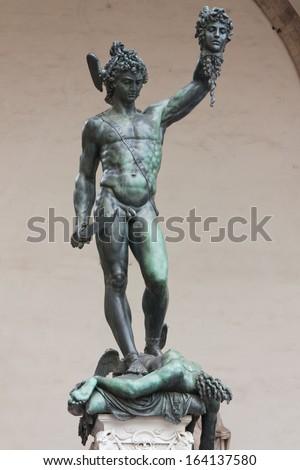 Bronze statue of Perseus holding head of Medusa in Piazza della Signoria, Florence, Italy - stock photo