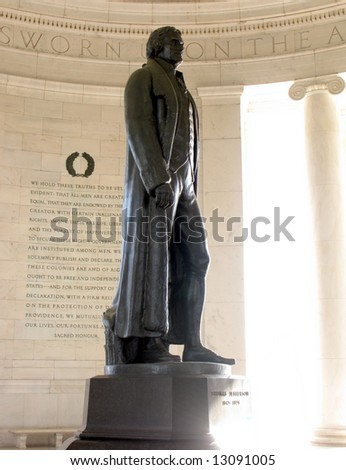 Bronze statue of Thomas Jefferson in front of engraved wall with text of the American Declaration of Independence at the president memorial in Washington DC - stock photo