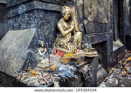 Bronze statues with incense near Hindu temple and Swayambhunath stupa in Kathmandu, Nepal    - stock photo