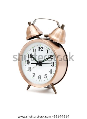 bronze vintage alarm clock isolated on white background