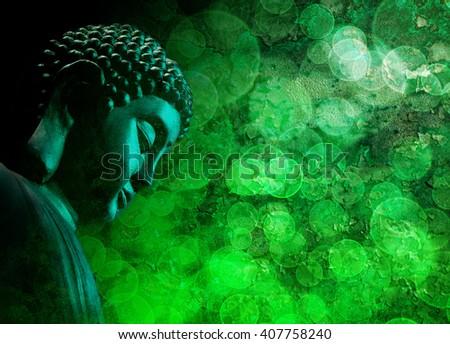 Bronze Zen Buddha Statue Meditating with Blurred Textured Green Background - stock photo