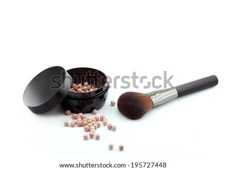 bronzing pearls powder  and makeup brush   - stock photo