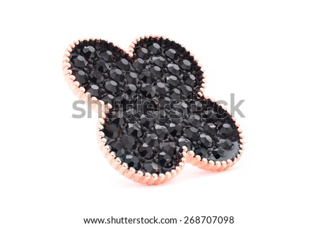 brooch in the form of a black flower on a white background - stock photo