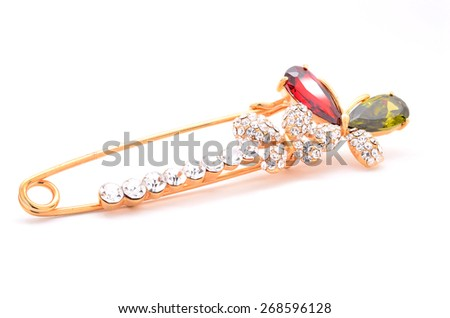 brooch in the form of a pin with butterfly on a white background - stock photo