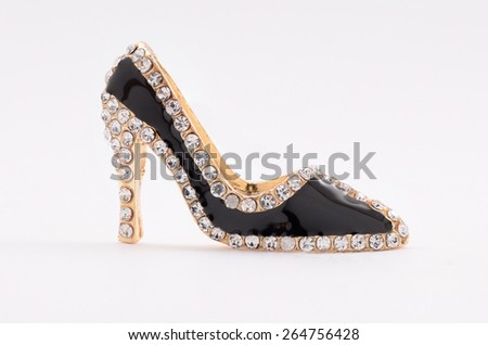 brooch in the shape of shoes on a white background - stock photo