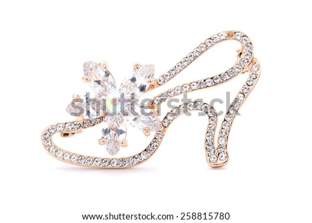 Brooch shoe on a white background - stock photo