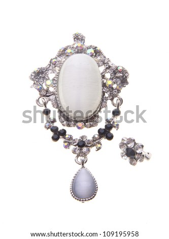 brooch with different gems on a background. - stock photo