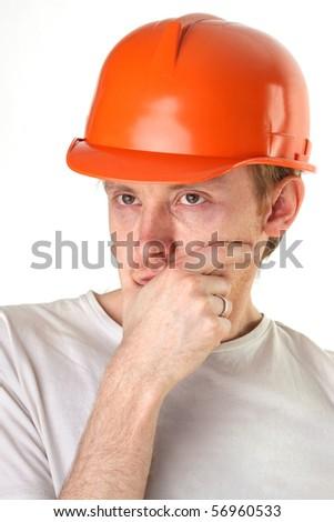 brooding architect engineer in orange construction helmet - stock photo