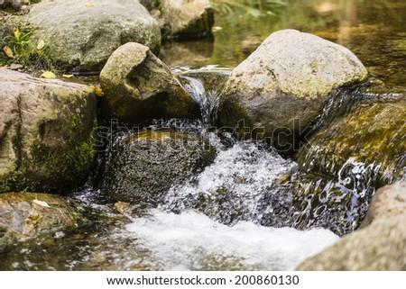 brook with stones - stock photo