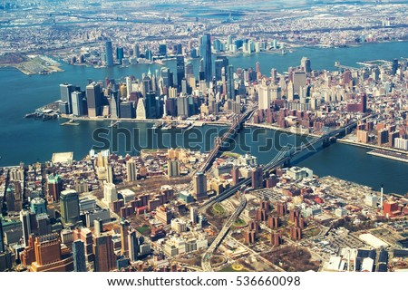 Brooklyn and Manhattan bridges from the airplane window.