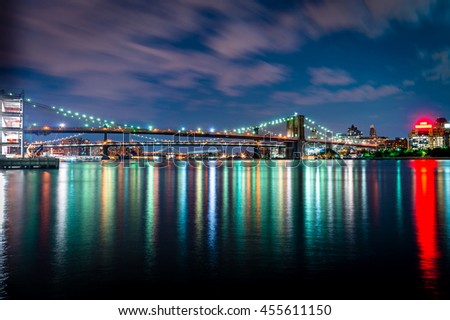 Brooklyn Bridge and Brooklyn skyscraper at dusk viewed from the Brooklyn Bridge Park in New York City. - stock photo