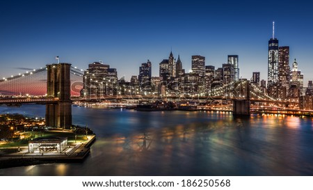 Brooklyn Bridge and Downtown Manhattan at dusk - stock photo