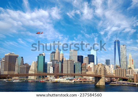 Brooklyn Bridge and Lower Manhattan skyline, New York City - stock photo