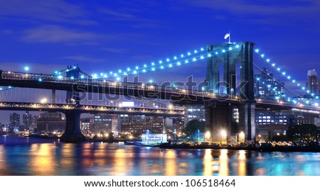 Brooklyn Bridge and Manhattan Bridge spanning the East River towards Brooklyn in New York City.