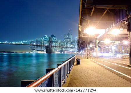 Brooklyn bridge and Manhattan in New York at night - stock photo