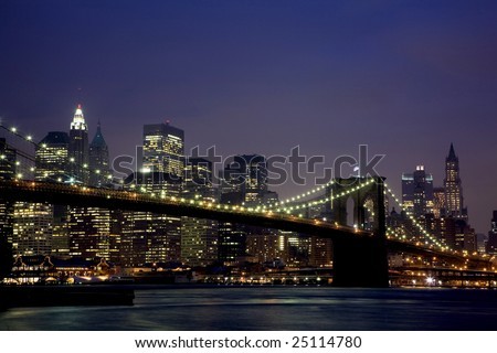Brooklyn Bridge and Manhattan skyline At Night 2008 - stock photo