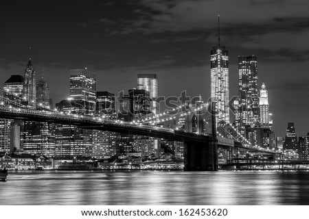 Brooklyn Bridge and Manhattan skyline at night in black and white - stock photo