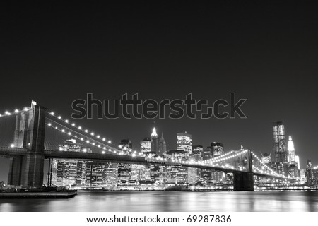Brooklyn Bridge and Manhattan Skyline View From the East River At Night, New York City - stock photo