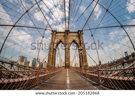 Brooklyn bridge and New York city in the background from a fish eye perspective - stock photo