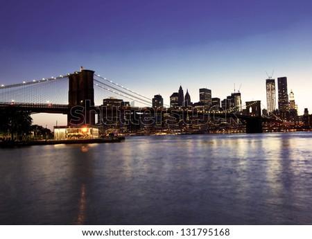 Brooklyn bridge and skyline at night - stock photo