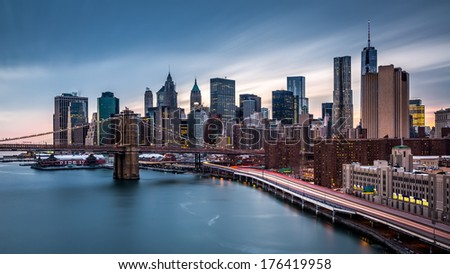 Brooklyn Bridge and the Lower Manhattan at dusk - stock photo